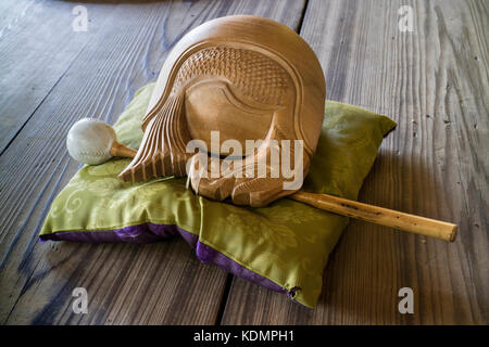 Kyoto, Japan - May 19, 2017: Traditional zen buddhist wooden fish gong, Mokugyo with a mallet on a pillow - Stock Photo