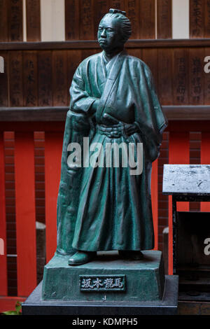 Kyoto, Japan - May 19, 2017: Stone statue of a traditional japanese samurai warrior - Stock Photo