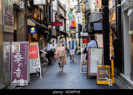 Kyoto, Japan - May 19, 2017: Tourists in Pontocho Dori Street, the chion district, at sundown - Stock Photo