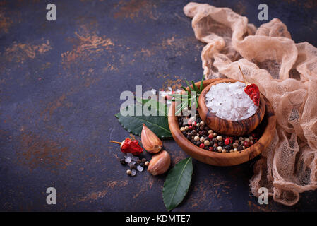 Herbs and spices on rusty background  - Stock Photo
