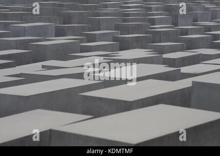 Gray stone rising up out of the ground that the holocaust memorial - Stock Photo