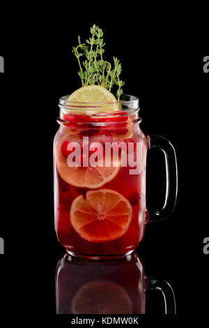 Cold cranberry mint cocktail with rosemary - Stock Photo
