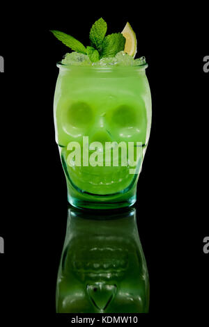 Scull glass with kiwi and lemon cocktail. Tiki cup. - Stock Photo