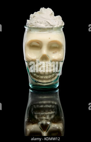 Scull glass with Coconut cream and rum cocktail. Tiki pot. - Stock Photo
