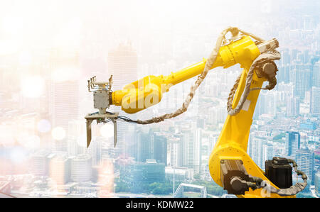 Heavy automation robot arm machine in smart factory industrial. Industry 4th iot and smart logistic , construction - Stock Photo