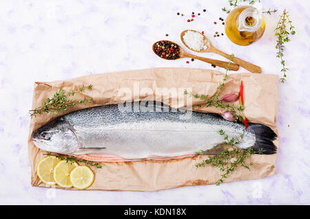 Fresh raw salmon red fish  on a light  background. Flat lay. Top view - Stock Photo