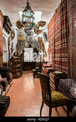 Tangier, Morocco - August 20, 2014:  Antiques dealer and souvenirs shop indoors, Tangier, Morocco