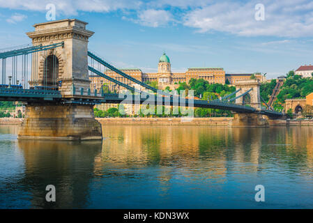 Budapest bridge Danube, view of the Lanchid Bridge spanning the Danube River with the Royal Palace in the background, - Stock Photo