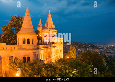 Budapest Fishermens Bastion, view of a turreted section of the Fishermen's Bastion at night illuminated by floodlights, - Stock Photo