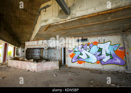 KUPARI, CROATIA - JULY 19, 2017 : The graffiti on the wall in the hallway of an old ruined hotel Goricina in abandoned - Stock Photo