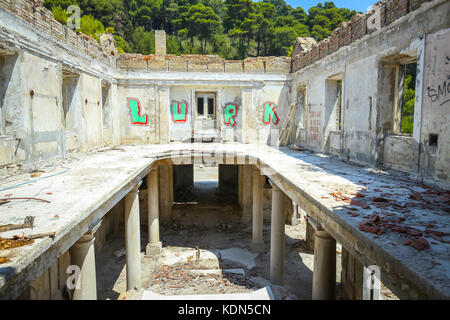 KUPARI, CROATIA - JULY 19, 2017 : The ruins of an old hotel Grand with graphite in abandoned Yugoslavian military - Stock Photo