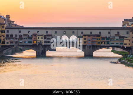 Sunset view at Ponte Vecchio bridge in Florence, Tuscany, Italy. - Stock Photo
