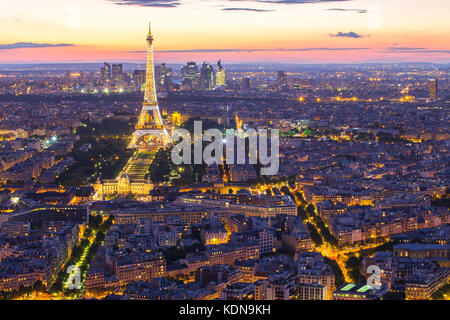 Paris, France - May 14, 2014: Cityscape with view of Eiffel Tower with Paris city skyline at night in France. - Stock Photo