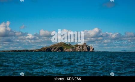 "Island ""Ireland Eye"" just off the Howth, Irish sea. View from the sea."