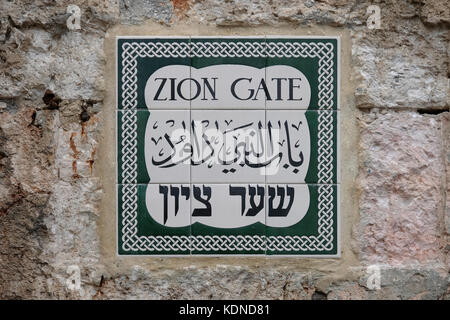 Sign on ceramic tiles in English Hebrew and Arabic at Zion Gate located at the southern edge of the Ottoman walls - Stock Photo