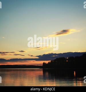 Sunset. Kenozero lake. Aged photo. Russian north. Beautiful northern landscape. Aged photo. Wild nature of Russian - Stock Photo