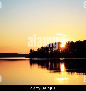 Sunset at Kenozero lake. Beautiful northern landscape. Aged photo. Wild nature of Russian North. Vintage photo. - Stock Photo