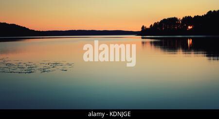 Beautiful northern landscape. Aged photo. Wild nature of Russian North. Sunset. Kenozero lake. Aged photo. Russian - Stock Photo
