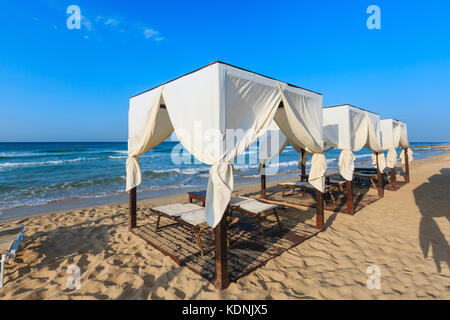 The most beautiful sea · Luxury beach tents canopies on morning paradise white sandy beach The Males of Salento (Pescoluse & Luxury beach tents canopies on morning paradise white sandy beach ...