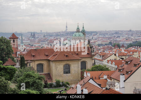 View from the Prague Castle towards the Charles Bridge. In the foreground is  the Church of the Virgin Mary - At - Stock Photo