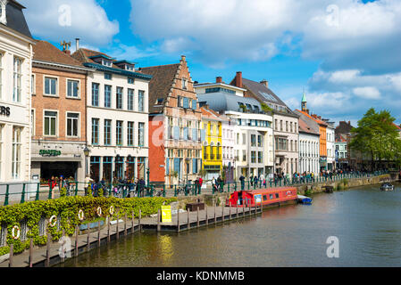 Ghent, Belgium - April 16, 2017: Old colorful traditional houses along the canal and boats in popular touristic - Stock Photo