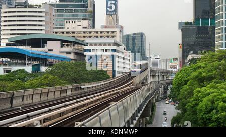 Bangkok, Thailand - June 8, 2017: The Bangkok Mass Transit System, BTS or Skytrain, Silom line, driving through - Stock Photo