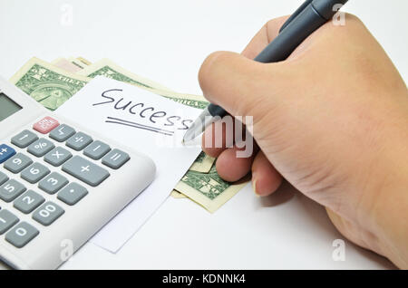 Hand written success word on paper. Business success concept - Stock Photo