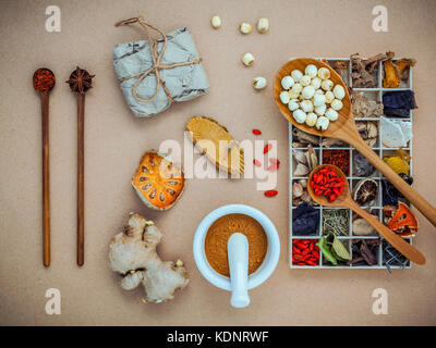 Alternative health care and herbal medicine. Dried various Chinese herbs in wooden box and lotus seeds in wooden - Stock Photo
