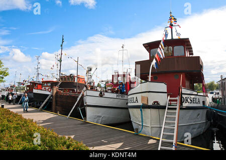 LAPPEENRANTA, FINLAND - JULY 21, 2013 - Regatta old boats. Boats built in the beginning of the last century, moored - Stock Photo