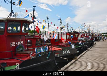 LAPPEENRANTA, FINLAND - JULY 21, 2013 - Regatta old motor boats. Boats built in the beginning of the last century, - Stock Photo