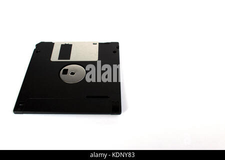 Black floppy disk isolated on white background (back side) perspective view - Stock Photo
