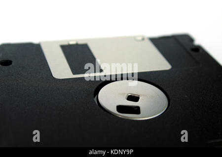 Detail of a black floppy disk isolated on white background (back side) - Stock Photo