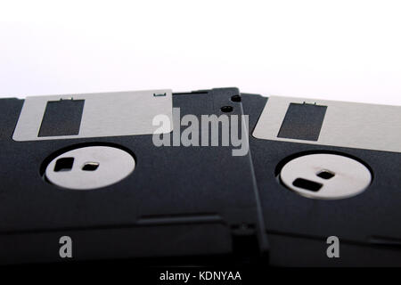 Detail of black floppy disks isolated on white background (back side) - Stock Photo