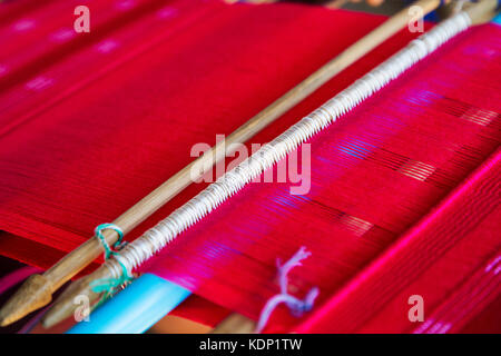 Detail of the traditional waving loom in Chiang Mai, Thailand - Stock Photo