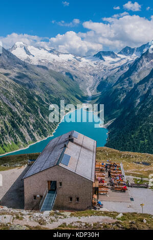 The Olperer  Hut mountain refuge in the Zillertal Alps overlooking the Schlegeis Stausee - Stock Photo