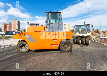 Samara, Russia - September 3, 2017: Road rollers working on the construction of new road in summer day - Stock Photo