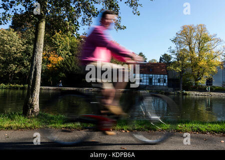 Cyclist on the bank of the Ruhr river, Mülheim an der Ruhr, Germany - Stock Photo