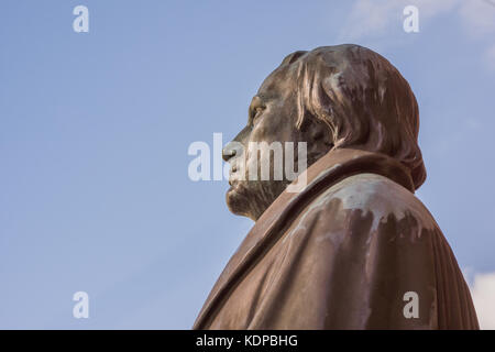 bronze statue of the reformer Martin Luther against blue sky. Profile from the left side. Copenhagen, July 6, 2016 - Stock Photo