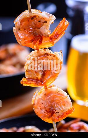 Grilled shrimp on bamboo skewers. Macro, closeup - Stock Photo