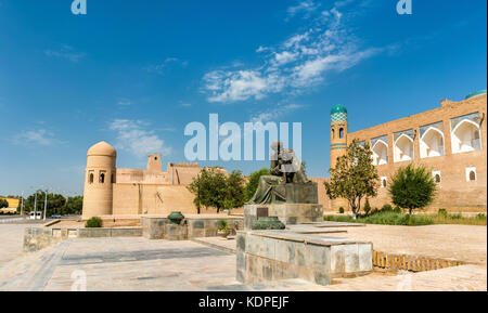Statue of Al-Khwarizmi in front of Itchan Kala in Khiva, Uzbekistan - Stock Photo