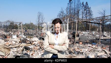 U.S. Sen. Kamala Harris walks through the remains of homes destroyed by wild fires sweeping across Sonoma County - Stock Photo