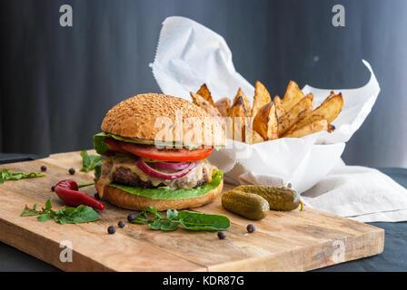 Tasty burger ready to eat - Stock Photo