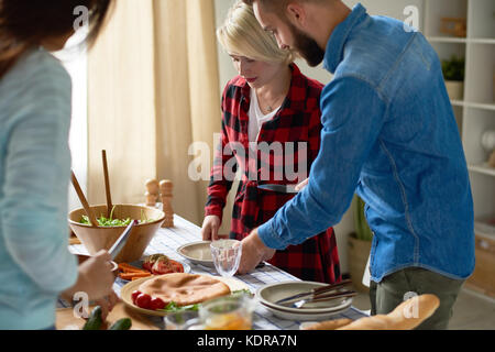 Young Friends Making Dinner - Stock Photo