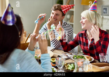 Happy Couples Celebrating Birthday  at Dinner Table - Stock Photo
