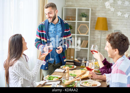 Friends Toasting at  Dinner - Stock Photo
