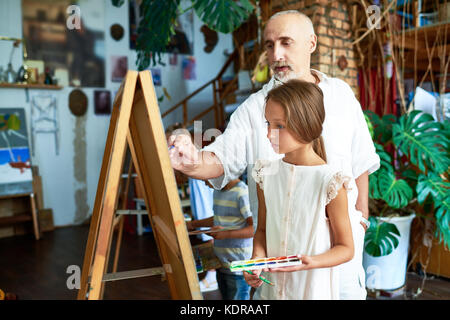 Senior Art Teacher in School - Stock Photo