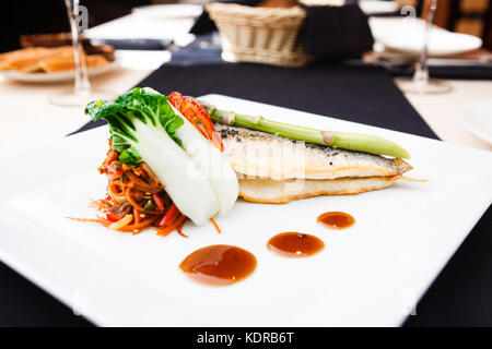 Bream fish with vegetables - Stock Photo