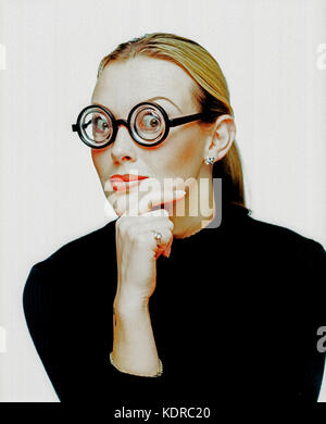 Young woman. Studio portrait. Thick lense spectacles. - Stock Photo