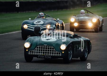 Aston Martin leads Jaguar at Goodwood nFreddie March Memorial Trophy - Stock Photo