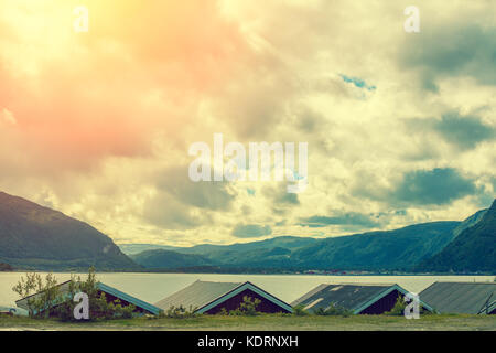 A row of fishermen's houses along a fjord. Nature Norway - Stock Photo